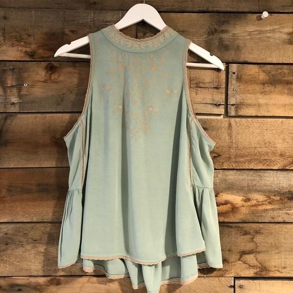 Tempted sleeveless blouse